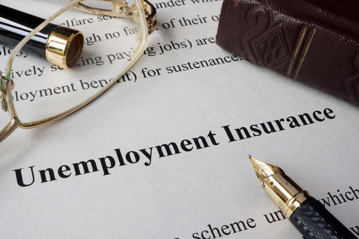 unemployment insurance concept written on a paper