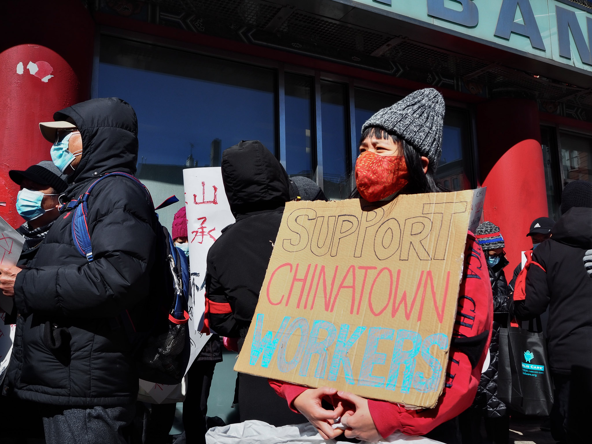Workers and their supporters protest the impending closure of Chinatown's Jing Fong restaurant dining room outside its landlord East Bank. Photo: Amir Khafagy for Documented