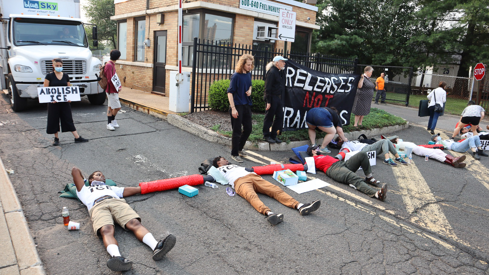 Activists blocked entrances to a DHS Investigations field office in Newark to protest the transfer and deportations of detainees.
